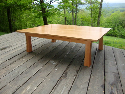 "This Japanese style tea table in cherry measures 50""(L) x 38""(W) x 14""(H) and offers generous space for four people."