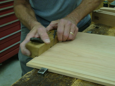 A rabbet plane makes quick work of sizing the panel so it fits snugly in the frame.