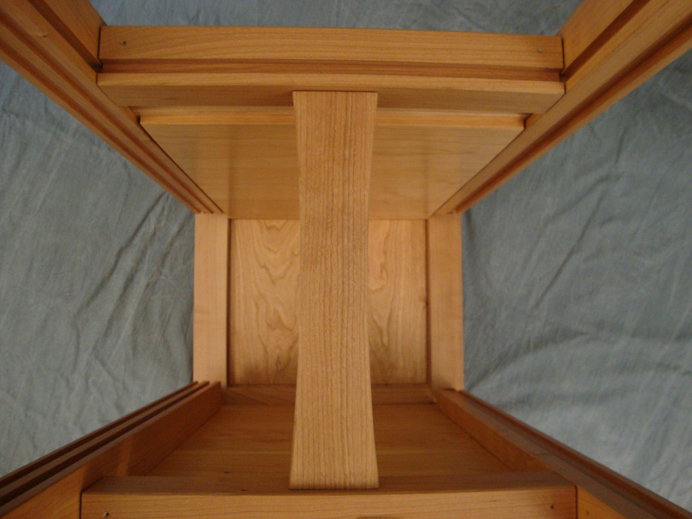 Next, the center support post is fitted into the top and bottom rail connectors without glue. Placing the center support post inside the cabinet eliminates the need for a visible supports attached to the upper and lower rails and ensures there is no deflection of the rails when people sit down on the bench.