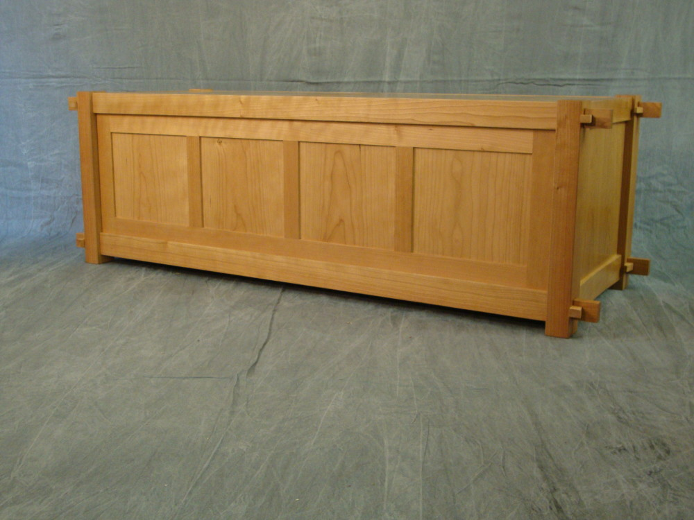 This is a view of the back of the tansu. The frame and panel construction of the rear panel is both strong and lightweight. With a finished back, this tansu can be used in a furniture grouping in the middle of a room.