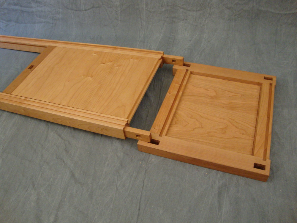 Next, the thru tenons on the lower rails are positioned in line with the lower mortises in the right side panel.