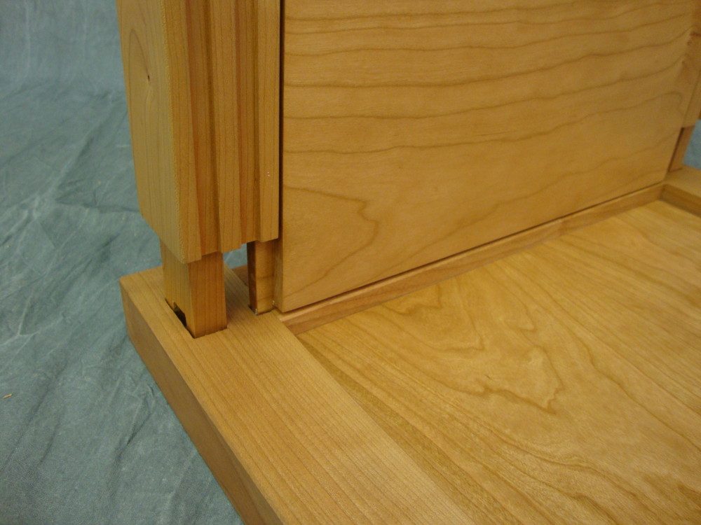 Here's a closer view of the thru tenon and mortise. The rabbeted edges of the panel are housed in the grooves in the rails with enough extra space to permit seasonal wood movement.