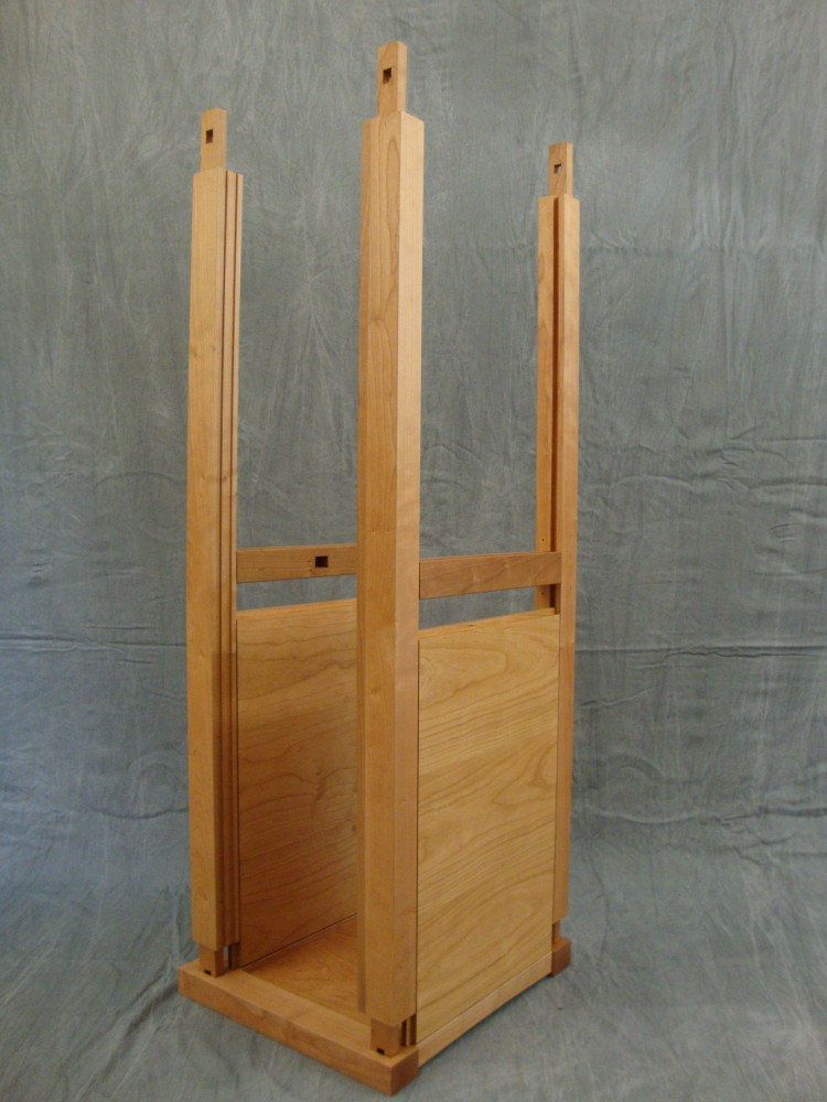 Both sets of rails with the right side panels inserted are fitted into the mortises on the right side panel.