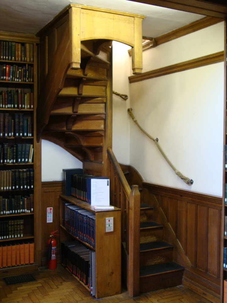 A view of the stairs from the ground floor to the mezzanine.