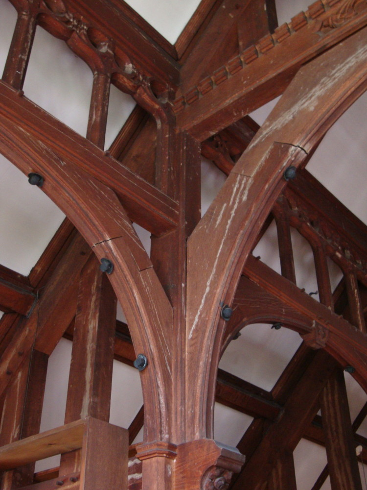 In this view, you can see the post, arched braces, collar and purlin, the longitudinal, horizontal member which supports the roof.