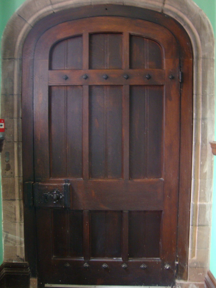 An interior view of another entry door fitted in a stone frame.