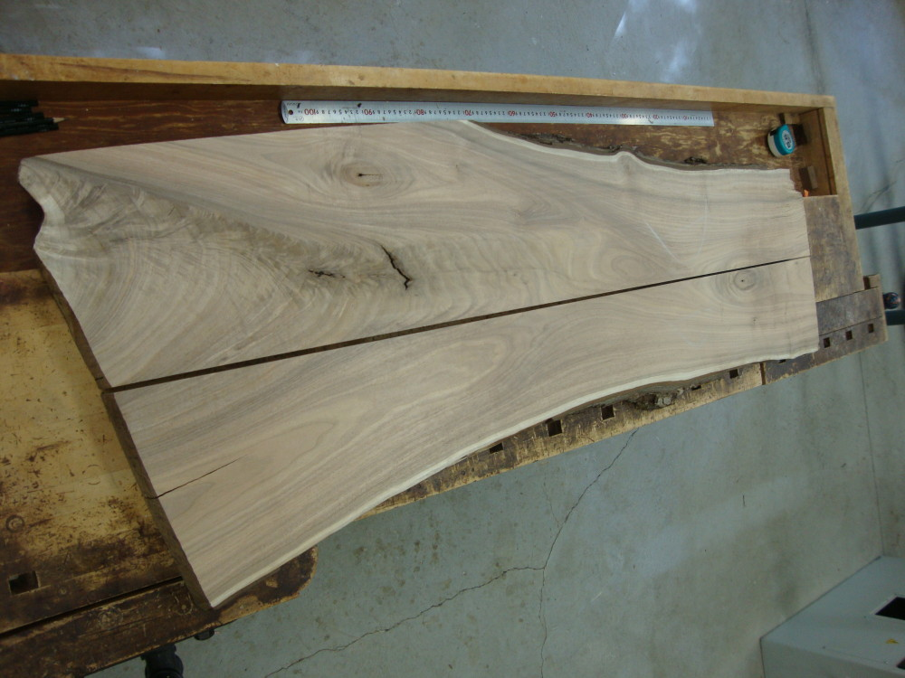 Here's a black walnut slab which I have ripped in half on the table saw.