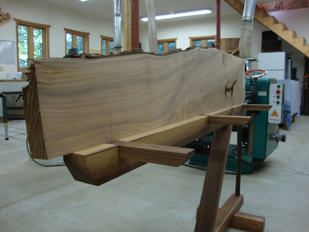 Positioning one half of the slab on the base to mark the locations for the sliding dovetails,