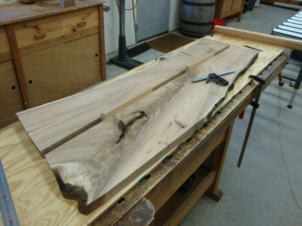 Preparing to cut the sliding dovetails. Note the two spacers which keep the two sides of the slab in parallel alignment.