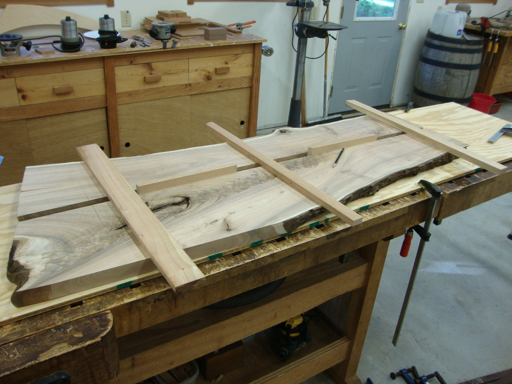 Position the guides to cut the sliding dovetails.
