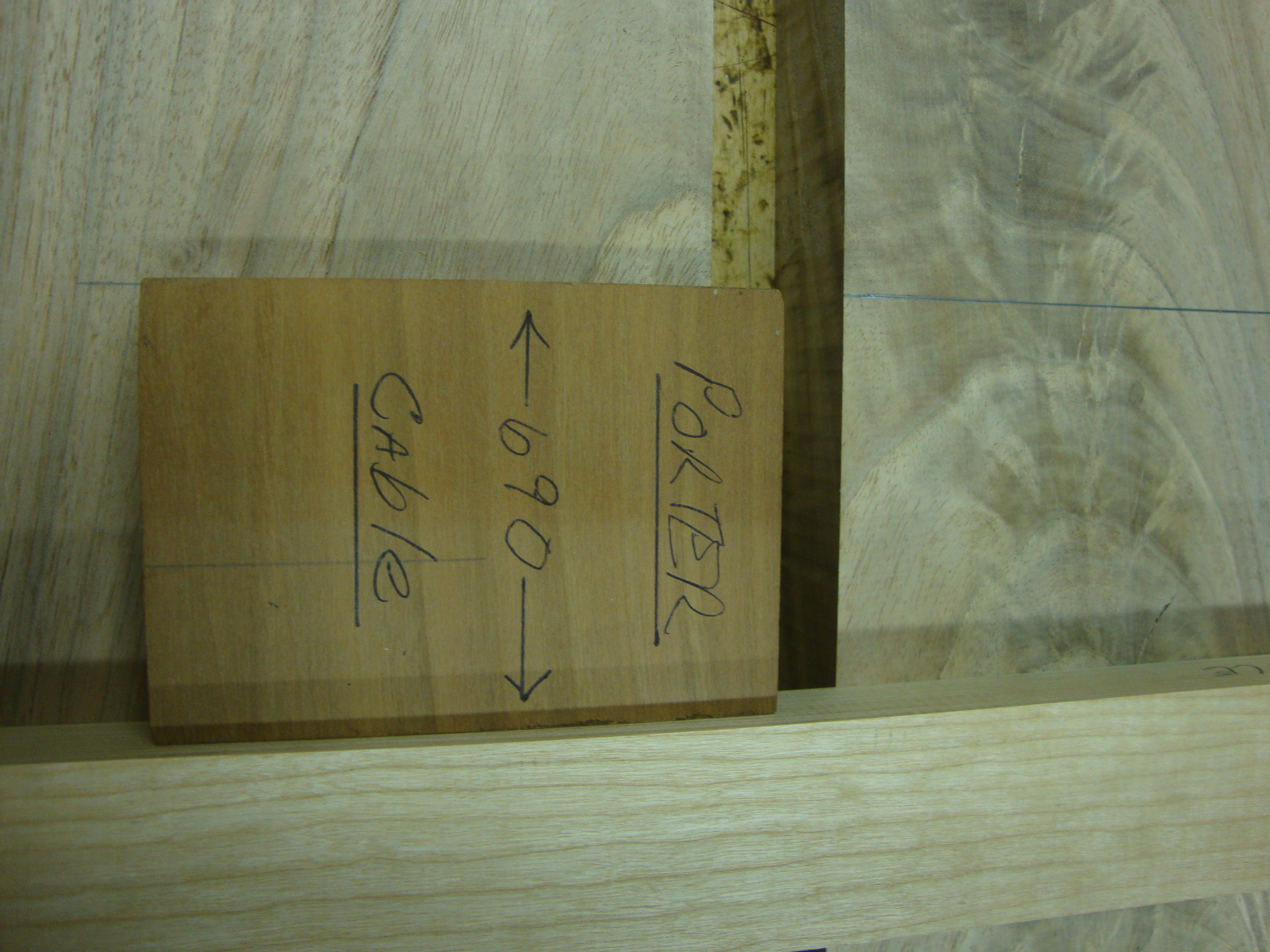 Use a shop-made jig to set the tool guides, in this case, one half the diameter of the router base.