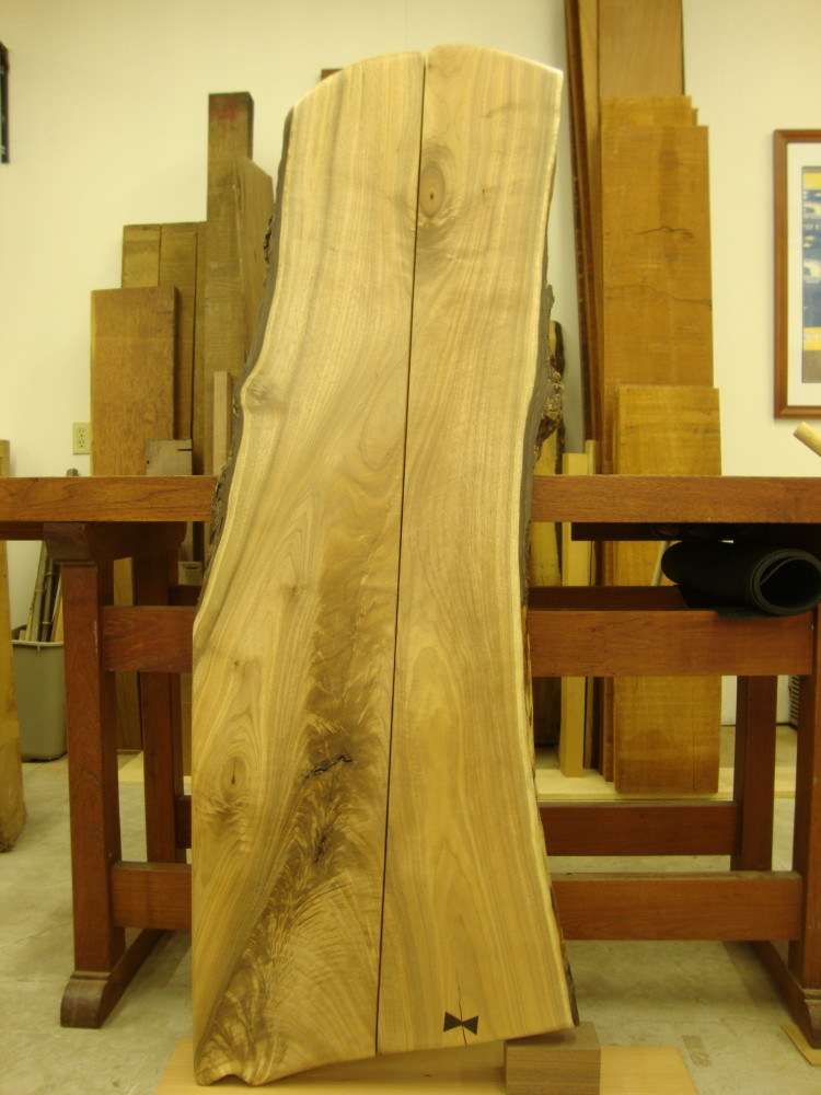 A black walnut slab made for a buffet sideboard. The slab has been ripped in half and joined with sliding dovetails.